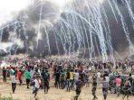 tindakanbrutalIsrael terhadap warga Palestina yang berdemonstrasi di perbatasan Jalur Gaza